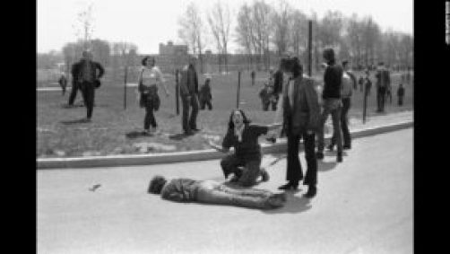 Mary Ann Vecchio screams as she kneels over the body of fellow student Jeffrey Miller during an anti-war demonstration at Kent State University, Ohio, May 4, 1970. Four students were killed when Ohio National Guard troops fired at some 600 anti-war demonstrators. A cropped version of this image won the Pulitzer Prize. (Photo by John Filo/Getty Images)