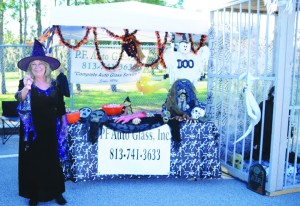 Donna Lee Fore of P. F. Auto Glass always goes all out of Riverview's annual Trick-or-Treat Street.