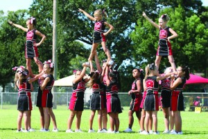 East Bay Buccaneers cheerleaders show off their skills half time during a recent game against the Turkey Creek Trojans.