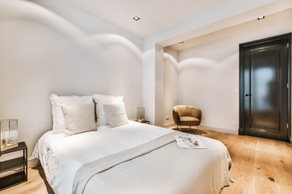 Interior of a cozy and bright bedroom with beautiful decoration