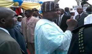 embattled 'Governor' Oyinlola in company of his 'guards'