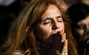 WOMAN PRAYS MASS MADRID