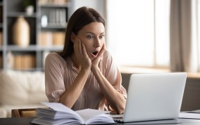 Amazed young woman read unexpected news online