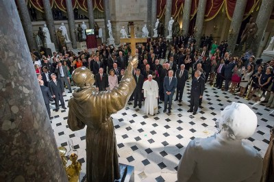 Pope Francis pauses in front of sculpture of St. Junipero Serra at the U.S. Capitol
