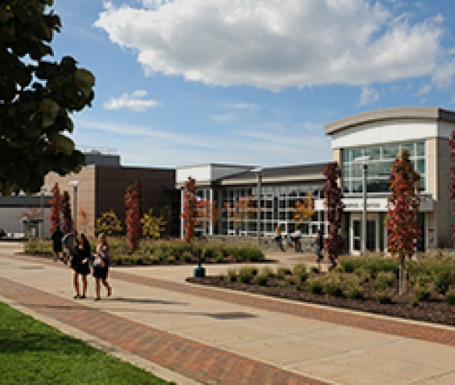 Students Walk In Front Of Marano Campus Center