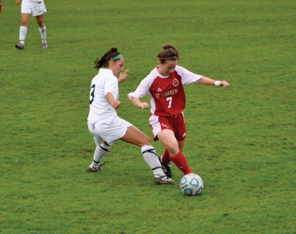 Raquel Vescio attempts to kick the ball away from St. Lawrence junior midfielder Brooke Hessney