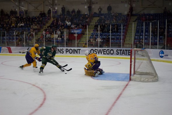 Freshman Chris Waterstreet was unable to convert on this breakaway opportunity during the second period Friday night versus Wisconsin-Stevens Point. Waterstreet's chance was one of several crucial ones for the Lakers during the second frame (Justin Dobrow | The Oswegonian).