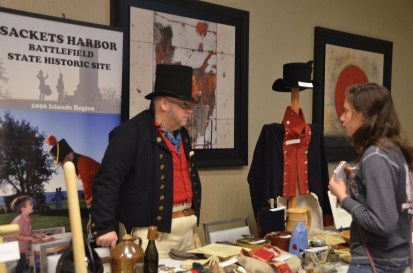 A presenter at the War of 1812 Symposium, put on by the Lake Ontario Event and Conference Center, displays items that soldiers would have packed with them during the war.  (Taylor Pangman | The Oswegonian)