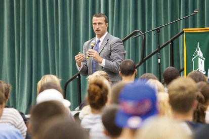Herren takes to Marano Campus Center Arena floor to inform kids on the risks of drug use.  (Photo provided by Sports Information)