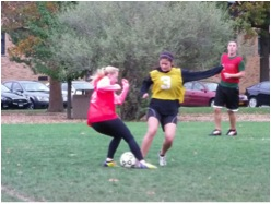 Kyleigh Kinney of Fake Madrid in an attempt to dribble around a member of the opposing team, Skillz that Killz, in the co-rec soccer league championship.  (Gabriela Santos   The Oswegonian)