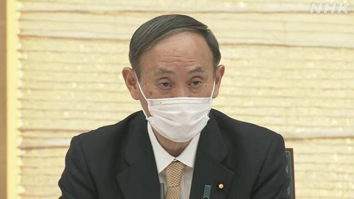 Yoshihide Suga covid-19
