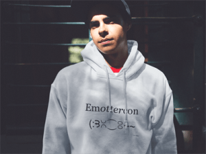 Young man wearing Otter Things EmOTTERcon white hoodie