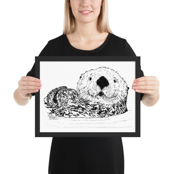 Pen & Ink Sea Otter Head Framed Poster with Person Mockup 12x16 in