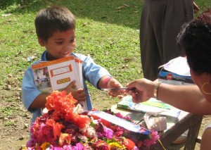 Students receiving their pens and notebooks
