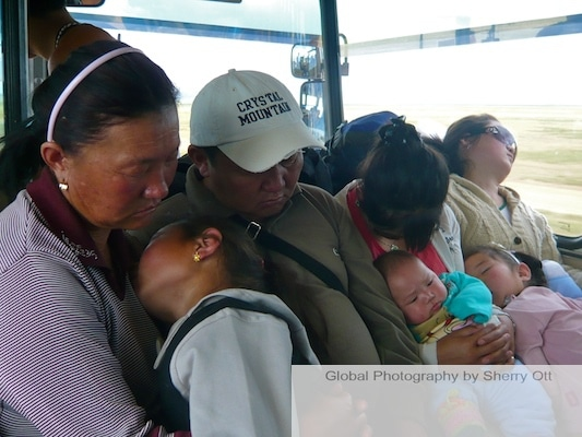 sleeping on a mongolian bus
