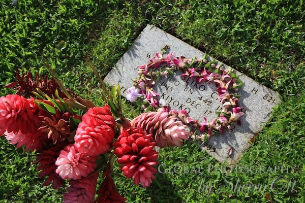 Lei left on a gravesite in the Punch Bowl