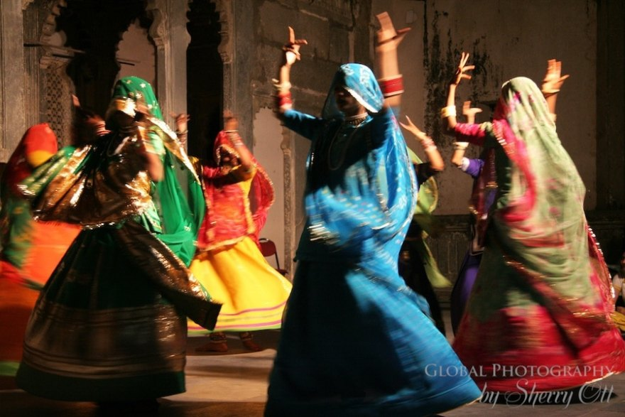 Indian women dance in colorful scarves in Udaipur