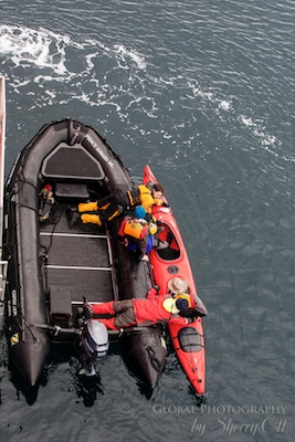 Getting in a kayak from the ship - things to do in antarctica