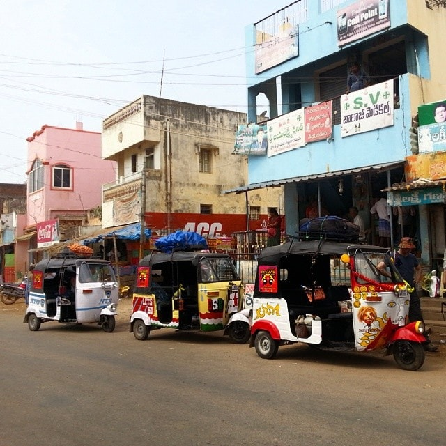 richshaw run convoy in the middle of India