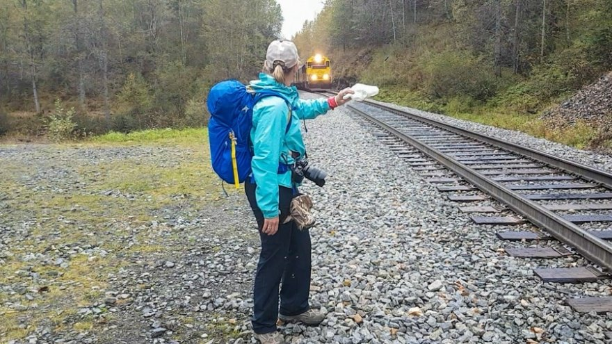 Flagging down the a train in Alaska