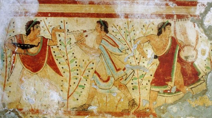 Muzikanten begeleiden een banket in de Tomba della Leopardi