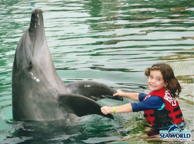 Keira with Starbuck the dolphin