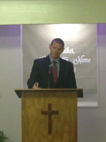 Pastor Derek Wheeland proclaiming Anchor Baptist an independent church