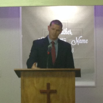 Pastor Derek Wheeland proclaiming Anchor Baptist an independent church