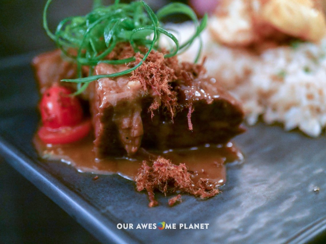 U.S. Beef Short Ribs Adobo (₱950). Garlic rice, cherry tomatoes, crispy egg