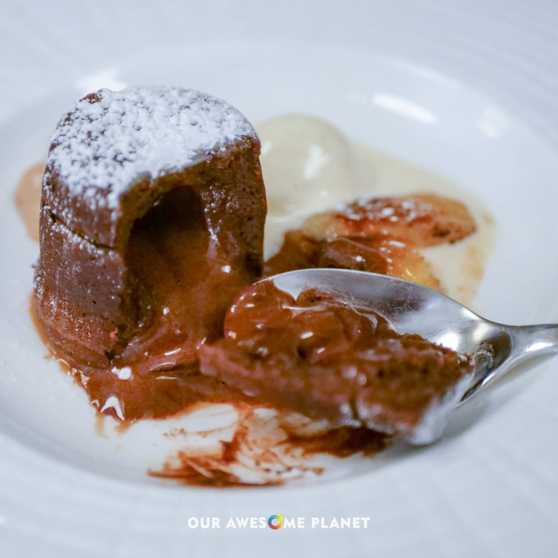 Hot Chocolate Souffle (₱360). Colombian coffee foam, caramelized banana, and vanilla ice cream.