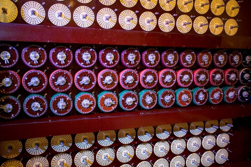 Working replica of Bombe machine in National Museum of computing just outside the fence at Bletchley Park.