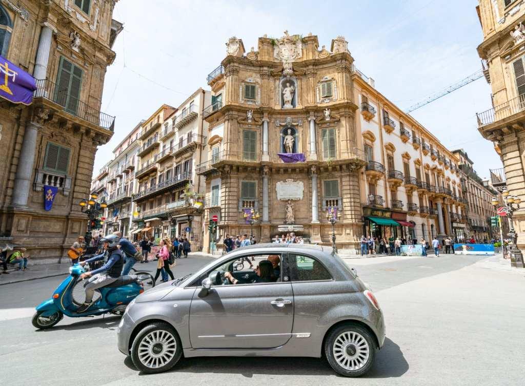 Car and Vespa in Quattro Canti, Palermo