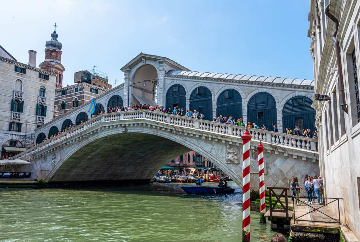 Photo of the Rialto Bridge from below, an essential stop on your 2 days in Venice itinerary!