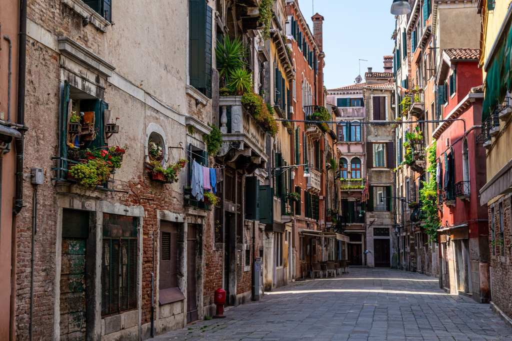 Quiet street in Venice with flowers in windows