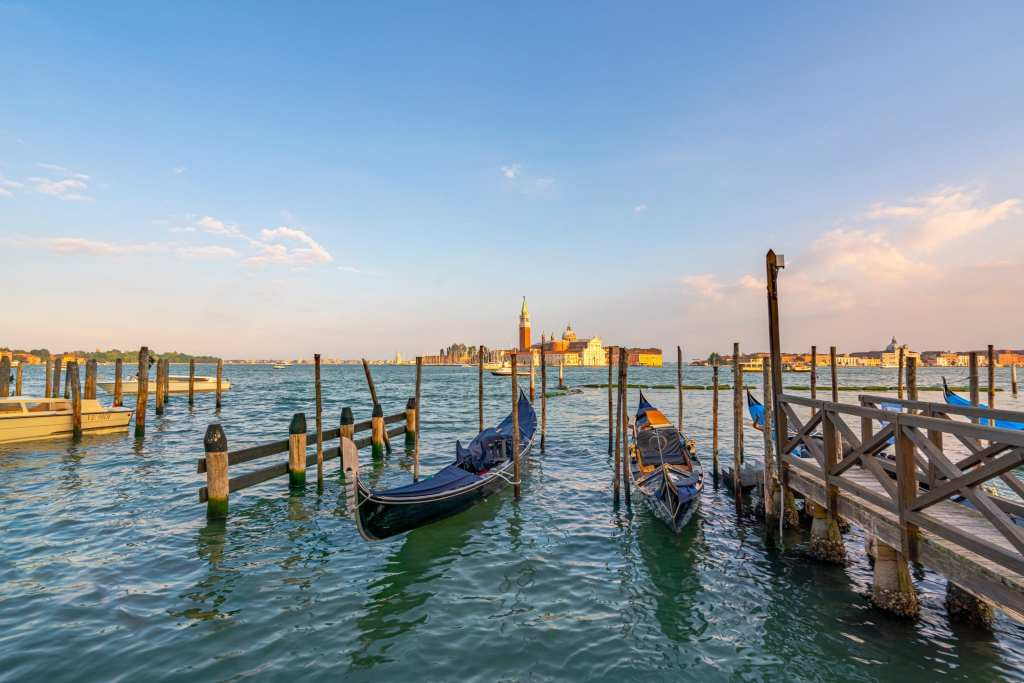 Gondolas in the Venetian Lagoon with San Giorgio Maggiore in the background--don't miss this spot when looking for the most instagrammable places in Venice!