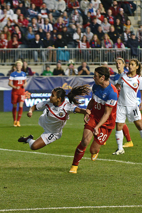 The USWNT's Abby Wambach scores one of her four goals on the night.