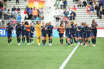 The French team acknowledging their supporters after the game.