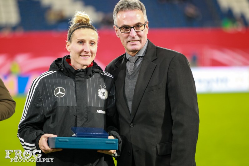 Anja Mittag is honored for amassing more than 100 caps for Germany.