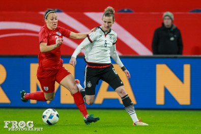 Lucy Bronze (ENG) and Simone Laudehr (GER) battle for the ball.
