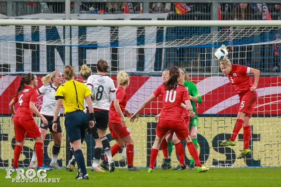 Stephanie Houghton (ENG) clears the ball.
