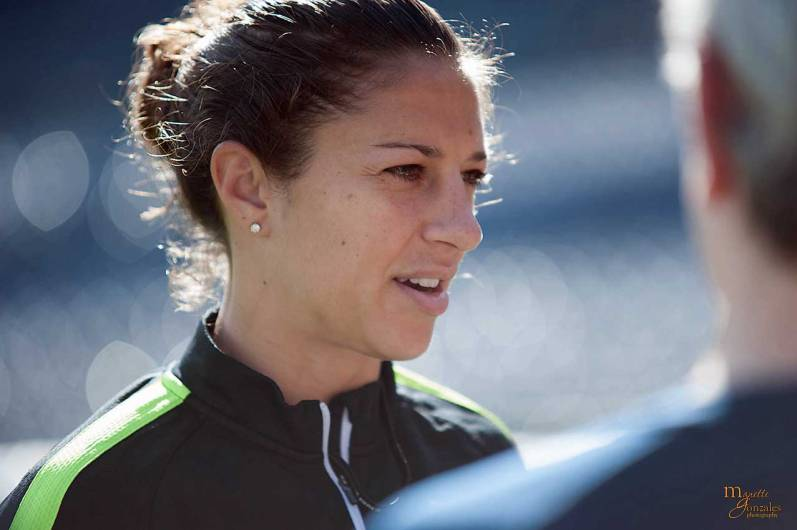 Carli Lloyd addressing the media during pregame practice.