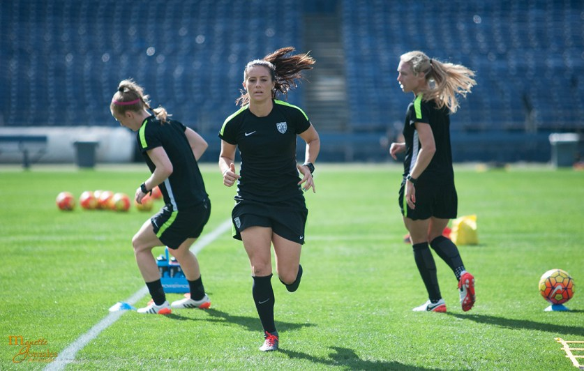 Becky Sauerbrunn, Ali Krieger, and Whitney Engen warming up during pregame practice.