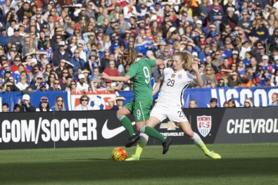 Ireland's Ruesha Littlejohn is challenged by the USA's Sam Mewis.