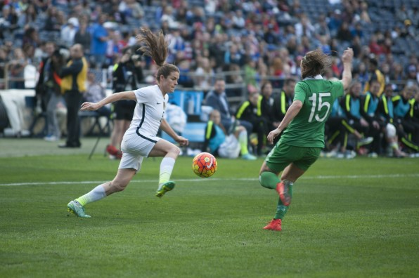 Kelley O'Hara (5) against Katie McCabe (15).