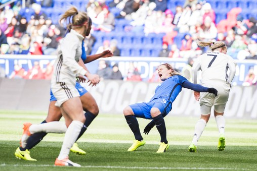 France's Eugénie Le Sommer and gravity having issues.
