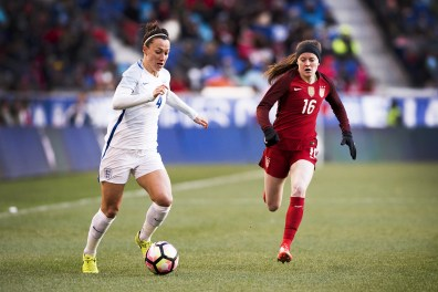 England's Lucy Bronze and the USA's Rose Lavelle.