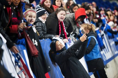 Mallory Pugh taking selfies with fans after a 2017 SheBelieves Cup match.