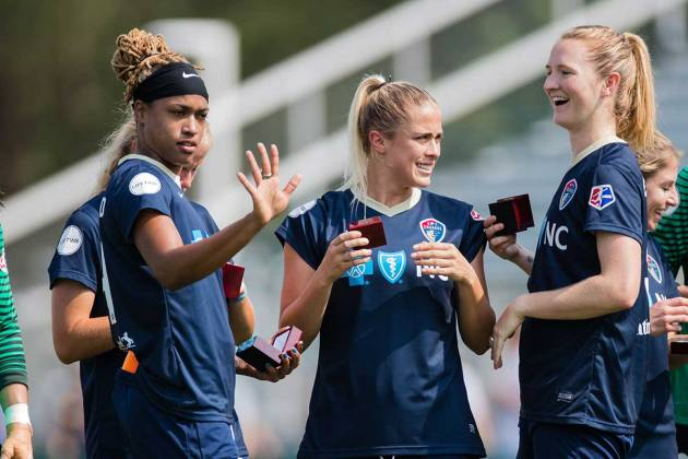 Jessica McDonald, Abby Dahlkemper, and Sam Mewis during the pregame ceremony. (Shane Lardinois)