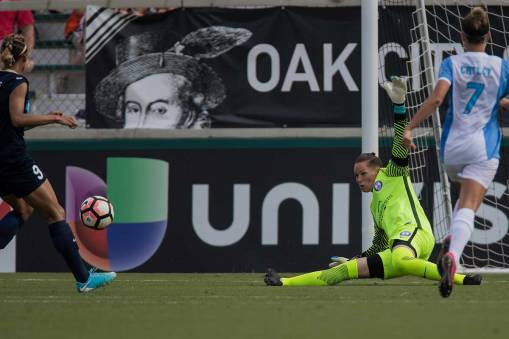 Ashlyn Harris gets low on the kick save. (Shane Lardinois)
