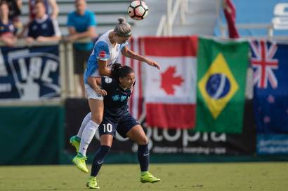 Alanna Kennedy wins the ball over Debinha. (Shane Lardinois)